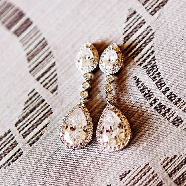 Crystal drop earrings added an elegant touch to Holly's bridal look.