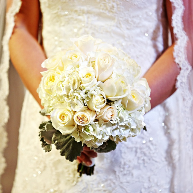 Holly carried an ivory and white bouquet filled with roses and hydrangeas.