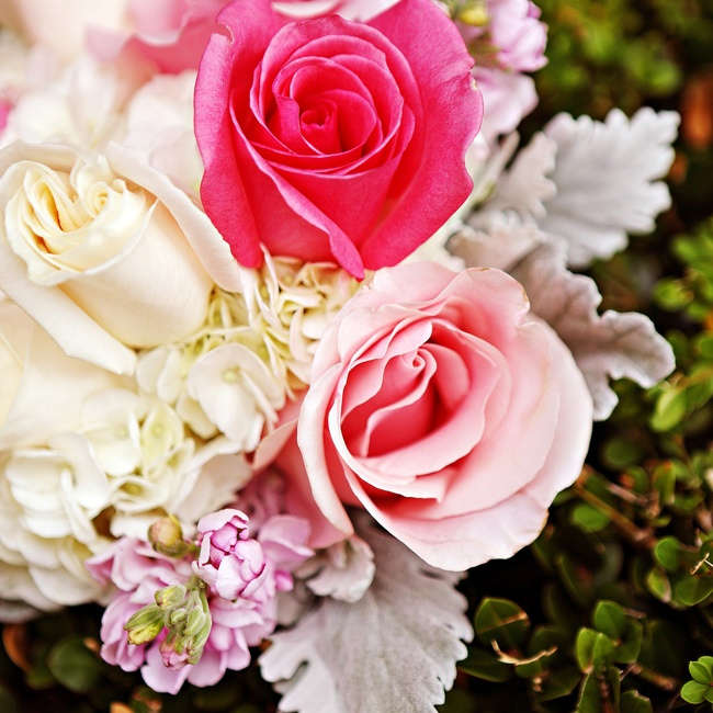 Bright and pale pink roses added a pop of color to the bridesmaids' bouquets.
