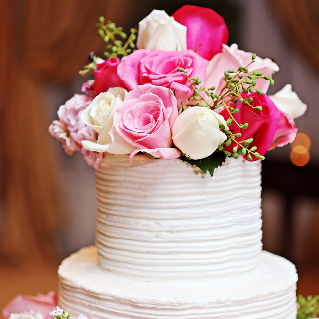 A bright bunch of light and dark pink roses, accented by eucalyptus berries topped the cake.