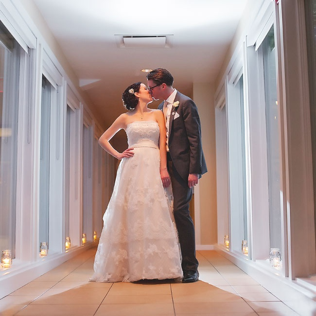 A lace and tulle overlay on the skirt of Amy's strapless A-line, Casablanca gown lent a romantic feel to her ensemble.