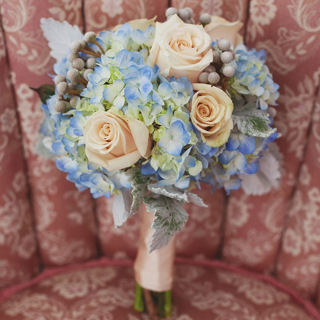 The bridesmaids carried vintage-style bouquets of roses, hydrangeas, brunia berries and dusty miller.