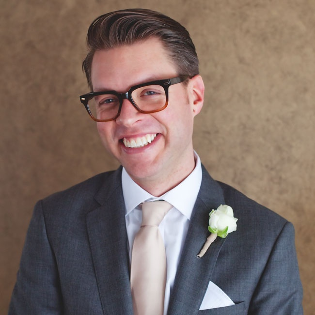 A single white bloom was pinned to the groom's lapel.