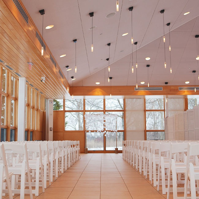 Amy and Neil kept their ceremony decor to a minimum, letting the floor-to-ceiling windows and views of the winter landscape take center stage.