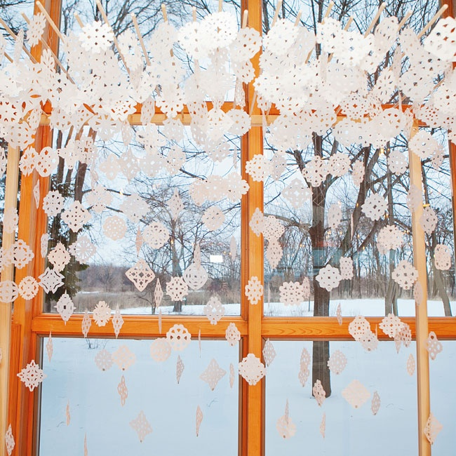The altar was handmade by a friend of the couple. More than 200 hand-cut snowflakes hung from the top for a light, airy feel.