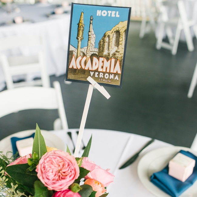 In lieu of table numbers, each table was named after a location that was special to the couple and labeled with a vintage postcard.