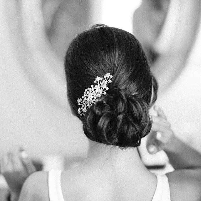 Adrianna wore a low, elegant updo accessorized with a silver jeweled hairpiece.