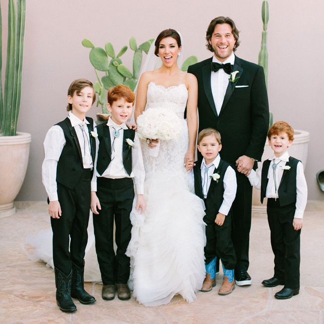 Young members of the wedding party donned matching black pants and vests and accessorized with turquoise bolo ties.
