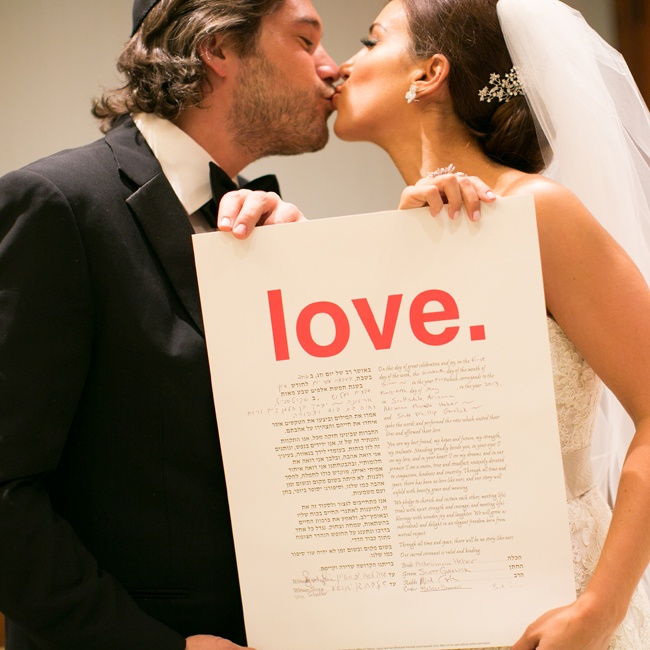 The couple took a photo of their marriage contract, translated in both English and Hebrew.