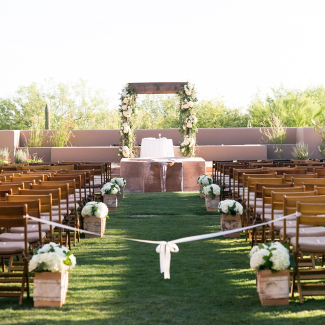 The romantic desert ceremony took place outdoors at the Four Seasons in Scottsdale, AZ.