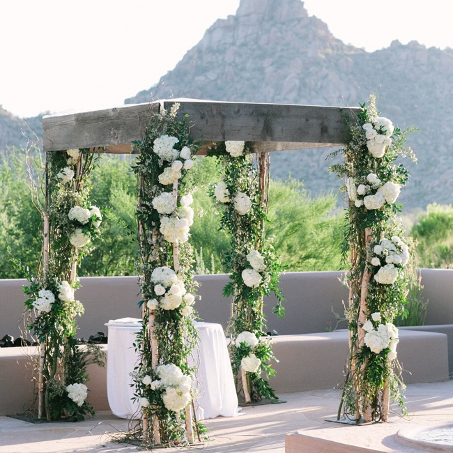 The couple were wed beneath this romantically decorated pergola.