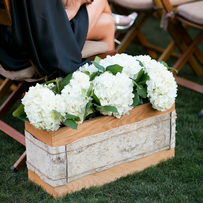 Lining the ceremony aisles were boxes of hydrangeas trimmed with birch bark.