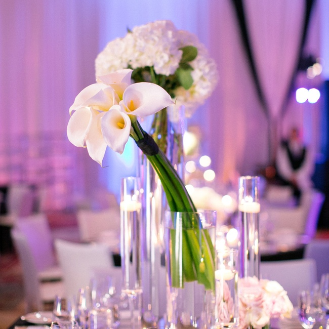 Centerpieces at the reception included bouquets of crisp calla lilies and hydrangeas in white.