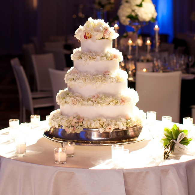 The wedding cake was a classic white, four-tiered round cake topped with fresh flowers.