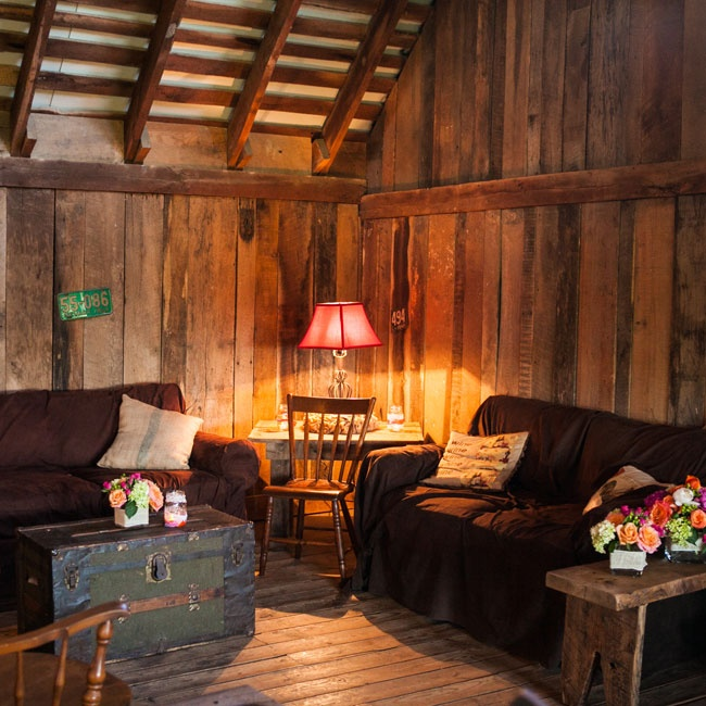 Farm tables, vintage trunks, wood chairs and antique license plates gave the lounge area a comfortable, rustic look.