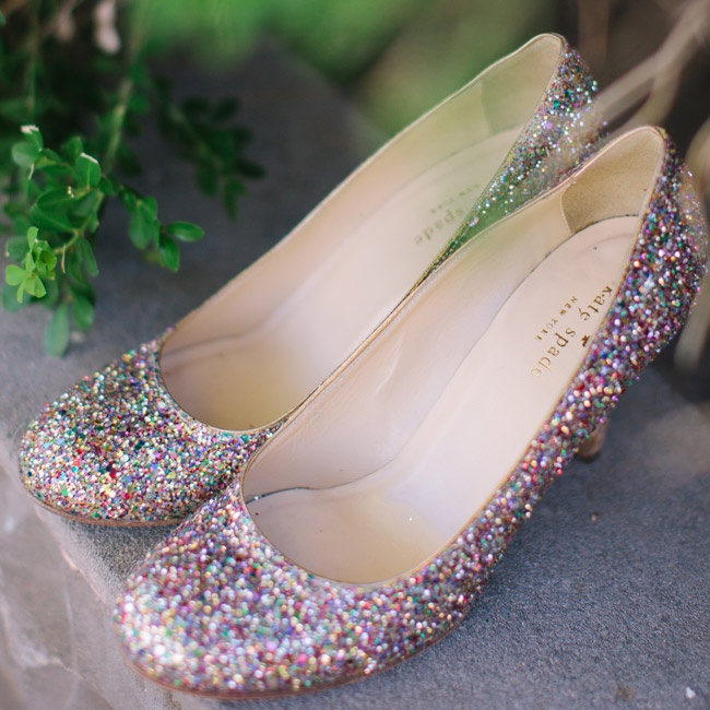 Christine walked down the aisle in a pair of glitzy bridal shoes decorated with colorful glitter.