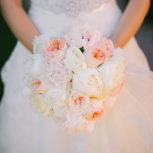 Christine carried a romantic bouquet of roses and peonies in soft a soft pink and white color palette.