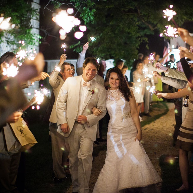 The newlyweds made their getaway through a tunnel of sparklers, held aloft by their guests.