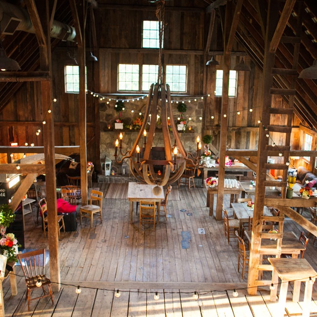 "While venue shopping with their parents, the couple saw a few signs for something called The Barns. They stopped by the next day and fell in love. ""It was the exact rustic look that we wanted and really just a beautiful location inside and out,"" says Erin. ""The date was available so we booked it that day, on the spot."""