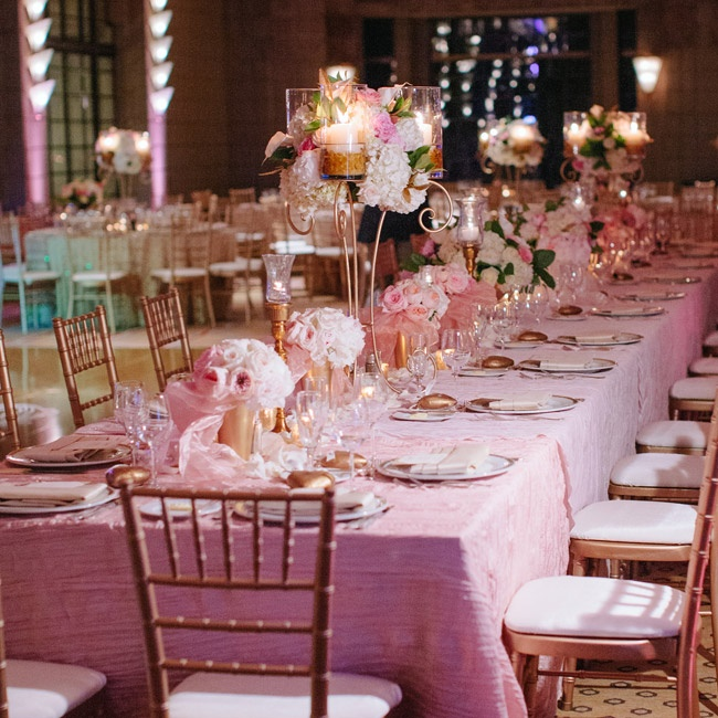 The couple wanted to create a classic and romantic atmosphere for their reception. The couple chose a pink and gold color palette, which they incorporated into everything from the lighting to the linens. The tables were spread with a mix of low and high centerpieces and plenty of candlelight for a warm, romantic glow.