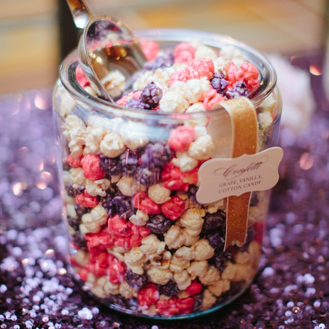 In addition to the cake, the couple set up a popcorn bar with their favorite flavors of popcorn for guests to take home.