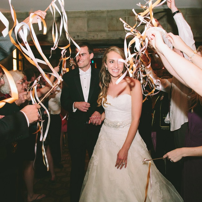 The couple exited the reception through a tunnel of flowing streamers.
