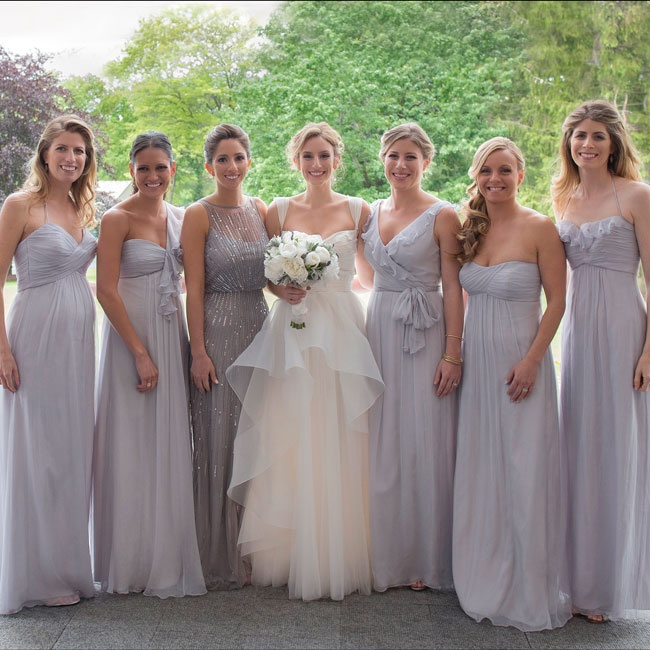 Jessica's bridesmaids wore grey floor length chiffon dresses in various styles.