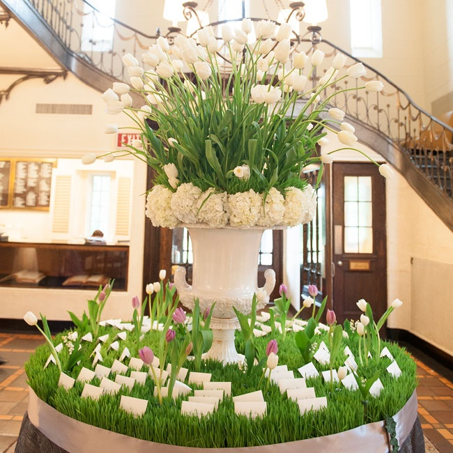 The escort table, upon entering the club, was inspired by the Spring season. The escort cards were placed within a bed of wheatgrass, while white tulips emerged from the base.