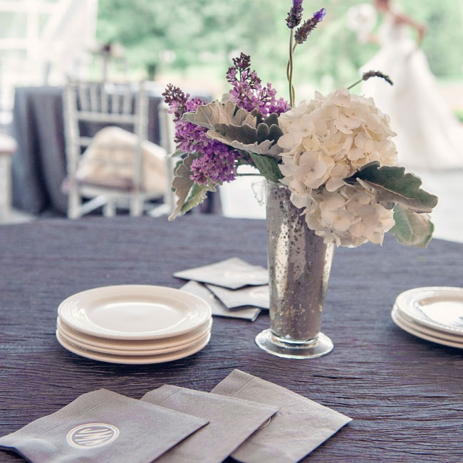 The centerpieces had four different styles of floral arrangements in mixed mercury glass vessels. The arrangements were created with a mixture of hydrangea, peonies, roses, lavender, lilac, and dusty miller.