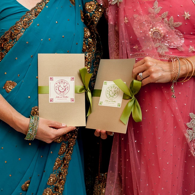 Guests were wearing traditional brightly colored saris for the ceremony. The ceremony programs were custom ordered with the couple's names on them in calligraphy and with green and red accents.