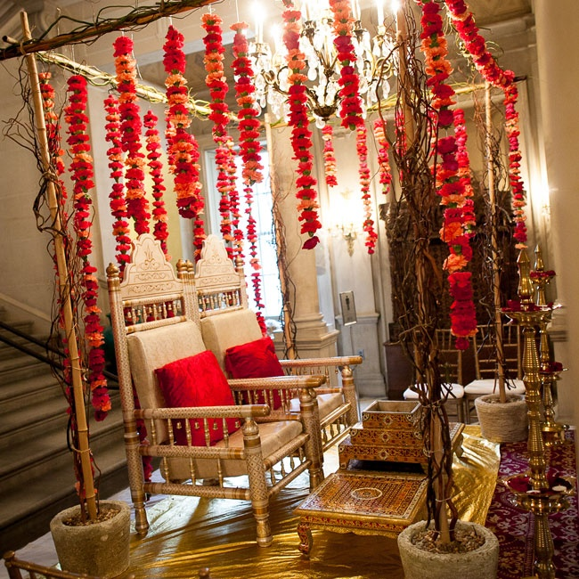 Jotika and Matt got married under a Mandip (wedding structure that is similar to a Jewish Chuppah)that was decorated with orange, red and magenta brightly colored flowers.