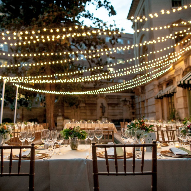 Strands of lights hung over the tables during the meal so that the guests could continue to enjoy the reception while sitting outdoors at The Anderson House.