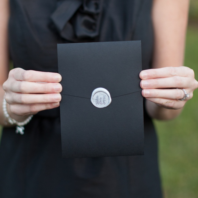 The couple's folded ceremony programs had an elegant old world flair with wax seals displaying their initials.