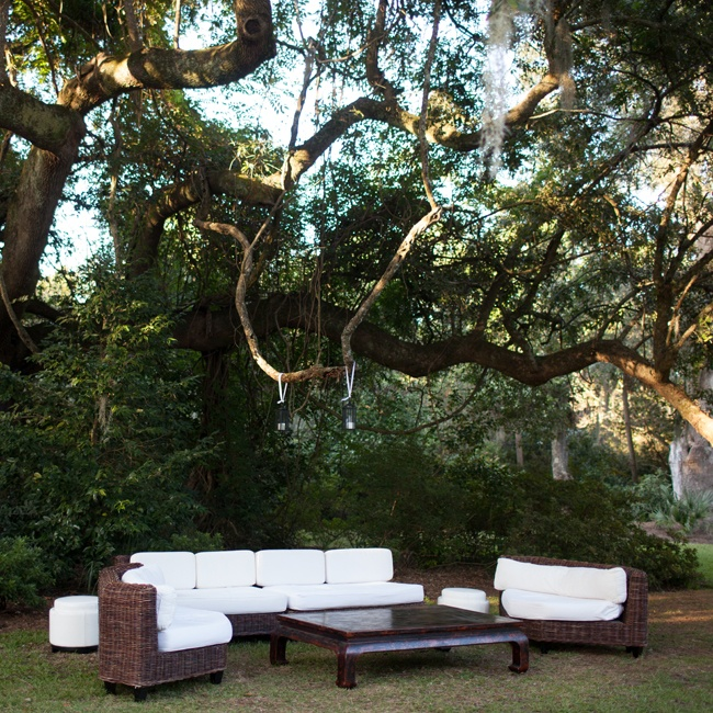 Chic kubu wicker couches and chairs with white cushions created an outdoor lounge where guests could relax during cocktail hour.
