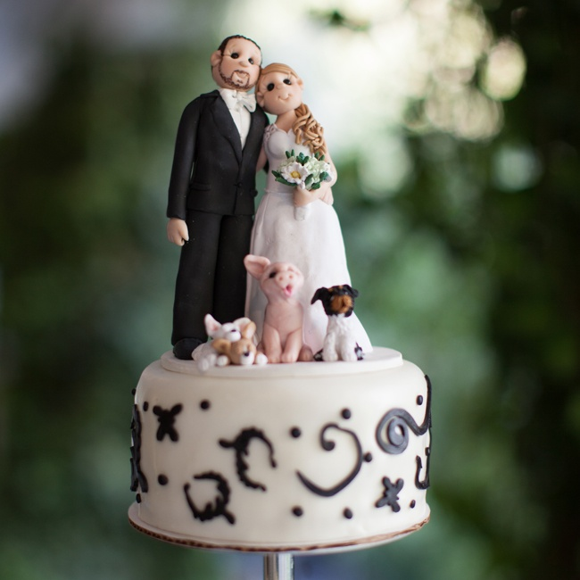 Ashlie and Clay had their cake topper custom made by Lynn's Little Creations on Etsy.com. The clay cake topper featured the couple and their four pets.