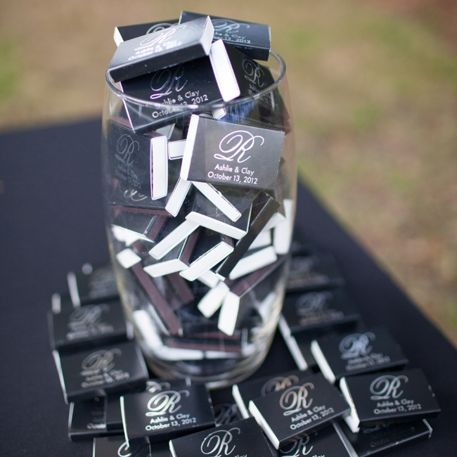 Black and white matchboxes with couple's initials and wedding date were available for guests to take home.
