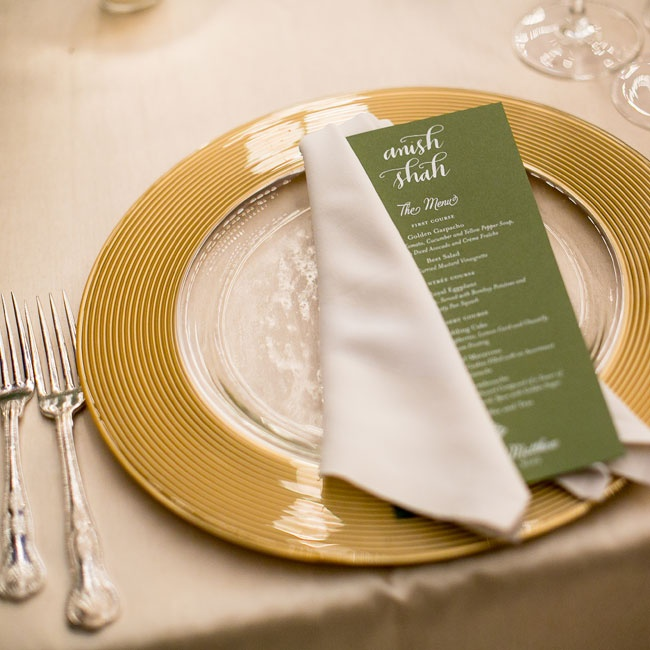 Each table setting had a green menu card with white calligraphy placed on a gilded gold plate.
