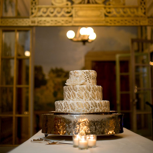The couple's wedding cake was a pound cake with lemon curd and fresh raspberries and was finished off with a gold embossed leaf detail to match to the gold color theme of the evening.