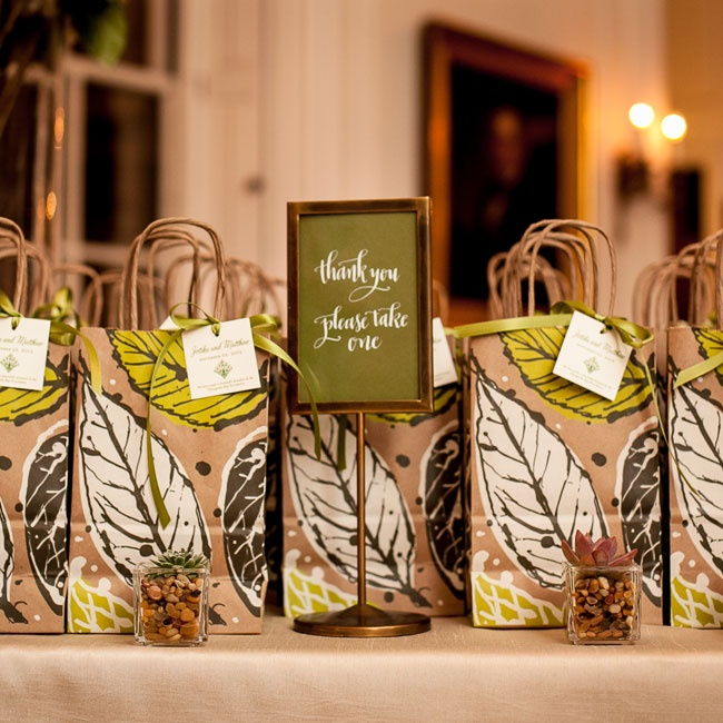 The couple wanted eco-conscious party favors for their guests to take home so they opted for ordering succulents that came in paper bags printed with a leaf pattern. The couple also made a donation to the Chesapeake Bay Foundation.