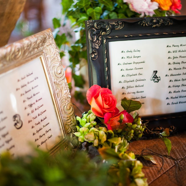 In lieu of place cards, ornate frames held lists of guests' names along with the coordinating table number.