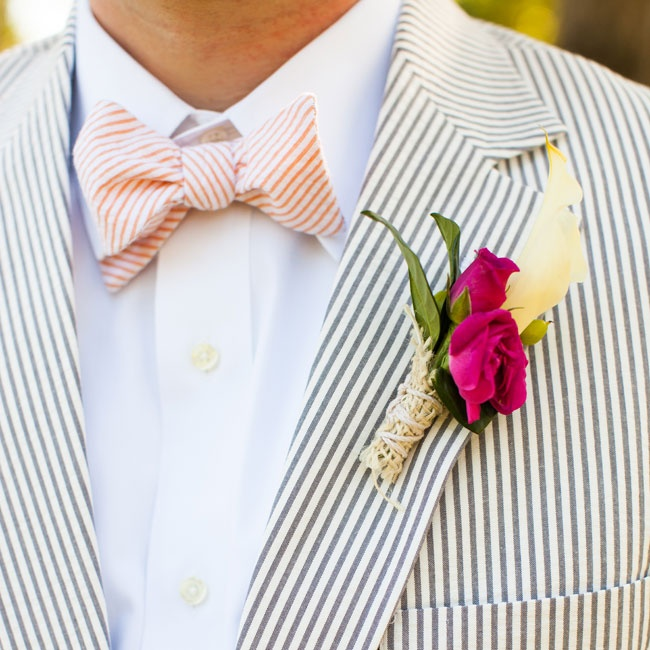 The men wore white calla lily and fuchsia rose boutonnieres.
