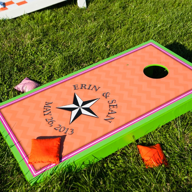 During the reception, guests were invited to play a variety of yard games including a custom corn hole game decorated with the wedding logo.
