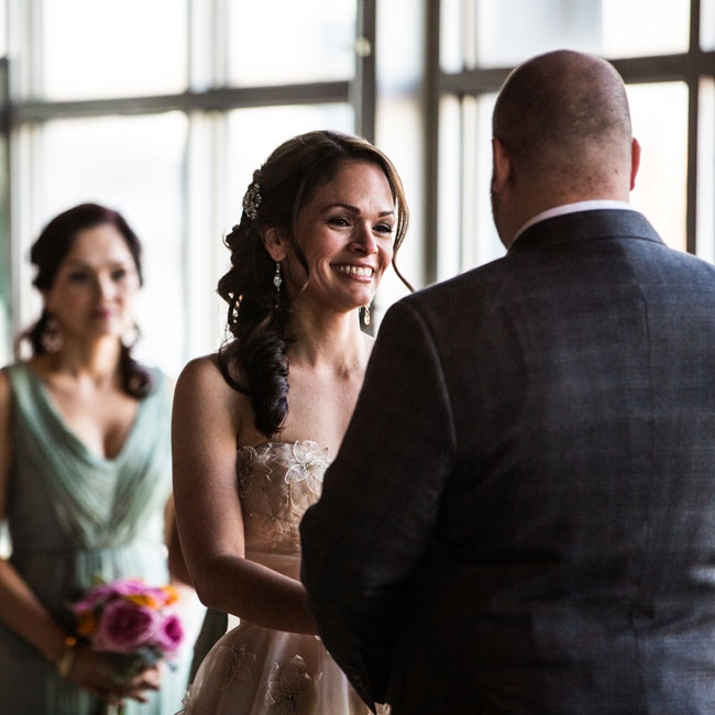 The couple tied the knot in front of the wall of windows in the museum's Decker Gallery, with the harbor as their backdrop.