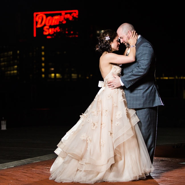 "The newlyweds took a spin on the dance floor to Jack Johnson's ""Better Together."""