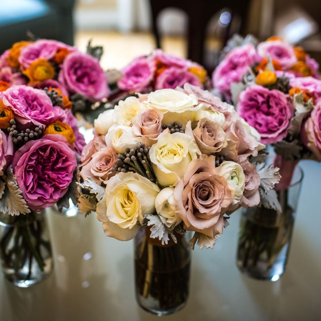 Danielle carried a hand-tied bouquet filled with Quicksand roses, ivory roses and ranunculuses and gray brunia berries.