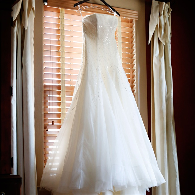 Stephanie's whimsical strapless Pronovias gown featured vines of sequins cascading down the bodice.