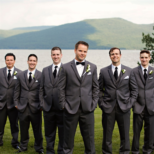 Groomsmen sported matching Vera Wang gray suits with black ties and white pocket squares while the groom stood out in a bowtie.