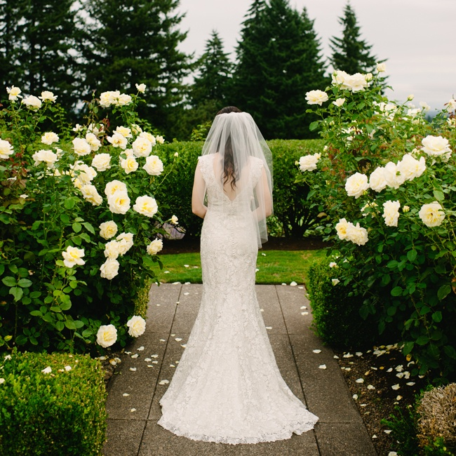 Sarah's Allure fit and flare gown had a vintage feel with a v-shaped neckline and embroidered lace overlay. The dress also featured a line of self-covered buttons down the back for a romantic feminine touch.