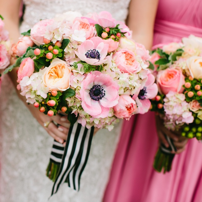 Bright pink peonies and peach hypernicum berries added a fun, modern touch to Sarah's bouquet.