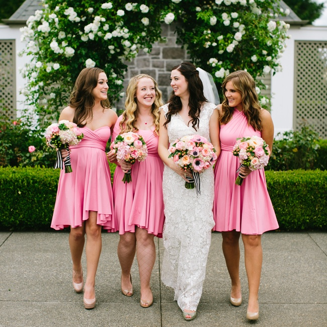 The bridesmaids wore short pink dresses in different styles, which they accessorized with nude pumps.